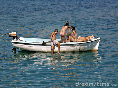 Children in summer fun on boat in sea 1