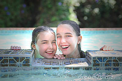 Children in a Swimming Pool During Summer