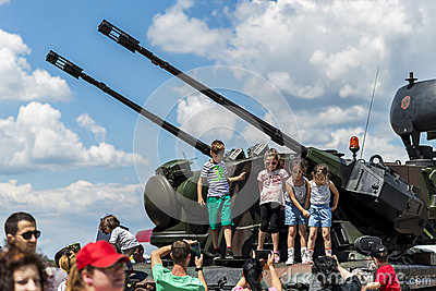 Children taking photos with anti-aircraft vehicle Editorial Photography