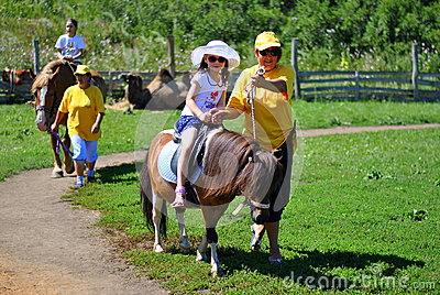Children taking pony ride Editorial Image