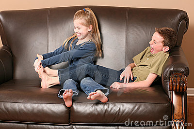 Children tickling feet