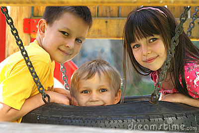 Children On A Tire Swing