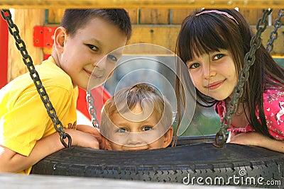 Children On A Tire Swing