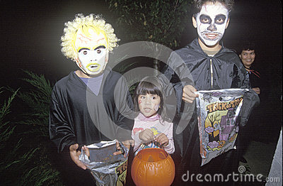 Children trick or treating for Halloween Editorial Stock Photo