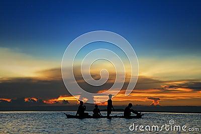 Children in tropical canoe
