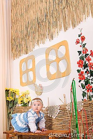 Children in Ukrainian national costume on bench
