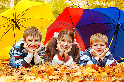 Children under umbrellas