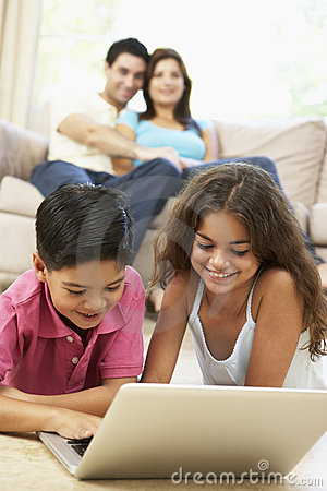 Children Using Laptop At Home