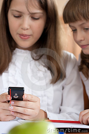 Children are using mobile phone closeup