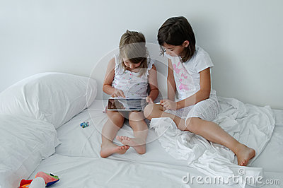 Children using tablet computer