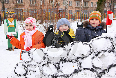 Children on wall of snow fortress in court yard