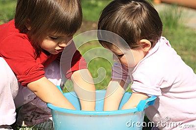 Children wash their hands