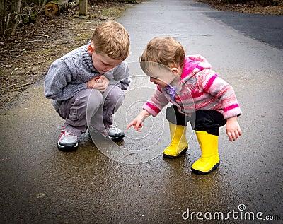 Children watch worm
