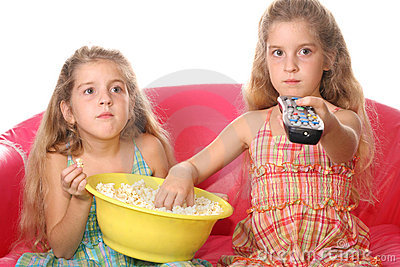 Children watching a movie eati