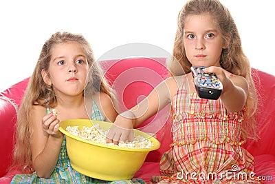 Children watching a movie eati