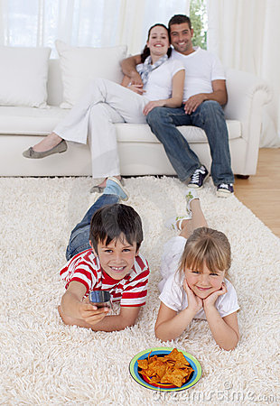 Children watching television on floor