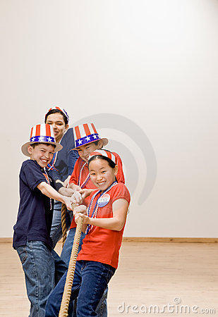 Children wearing American flag hats