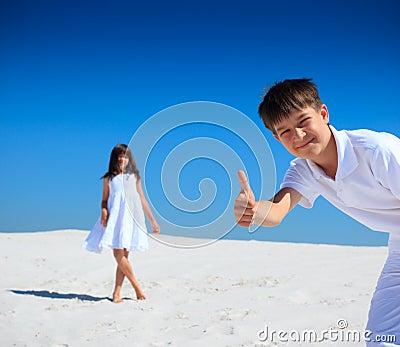 Children on white sand beach