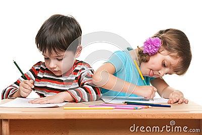 Children write at the desk