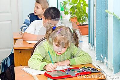 Children write at a lesson