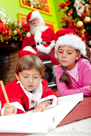 Children writing a Christmas letter