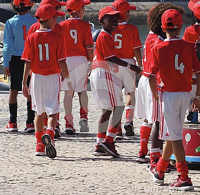 Free Childrens` Football Team In Uniform In Faro Portugal Royalty Free Stock Photo - 121604755