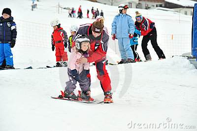 Childrens at ski school with ski instructors Editorial Stock Image
