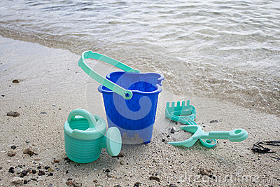 Childs green beach bucket and spades