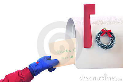 Childs hand placing letter in Mailbox isolated