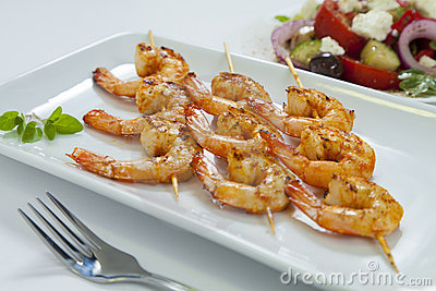 Chili prawn skewers with greek salad