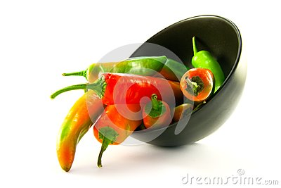 Chillis Spilling out of a Black Bowl