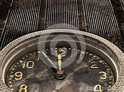 Chime. Clock. Watch mechanism on the old grungy metal background