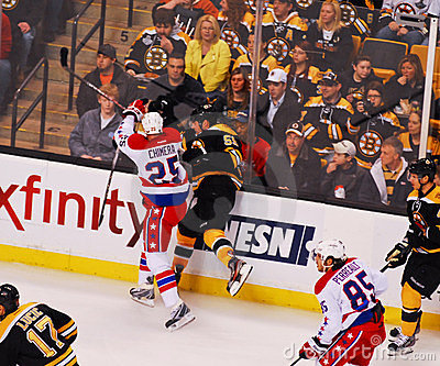 Chimera checks Johnny Boychuk (NHL Hockey) Editorial Photo