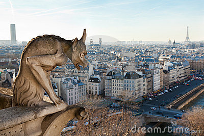 Chimera overlooking the skyline of Paris