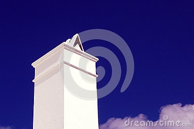 Chimney against blue sky