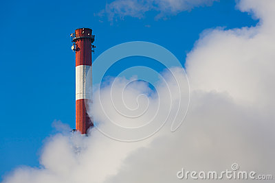Chimney in clouds of smoke.