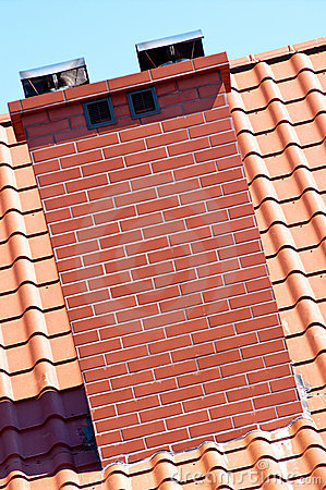 Chimney and red roof tiles