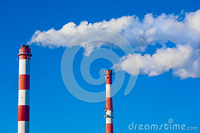 Chimneys with dramatic clouds of smoke.
