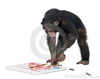 Chimpanzee drawing on a canvas