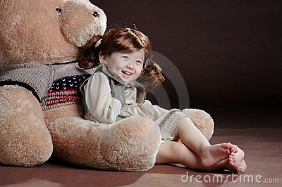 China girl in the teddy bear s arm