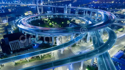 China Shanghai Nanpu Bridge with heavy traffic time lapse. At night with blurred motion