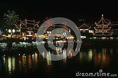 China Shanghai Yu Yuang Gardens the teahouse ancient shopping area and lake at night