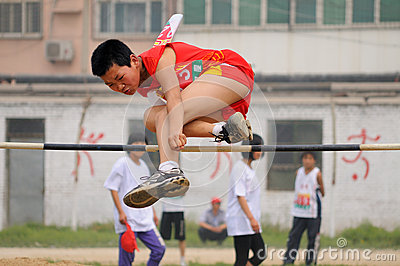 China: Student Track and Field Games /high jump Editorial Photo