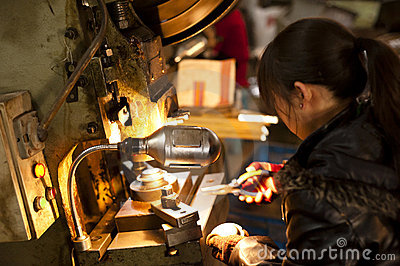 China: woman working in a factory Editorial Photography