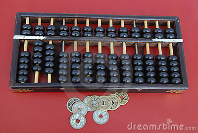 Chinese abacus with antique Chinese coins