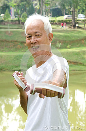 Chinese Asian senior man healthy lifestyle working out on a park
