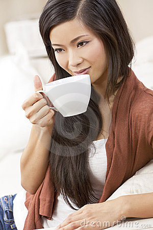 Chinese Asian Woman Drinking Tea or Coffee