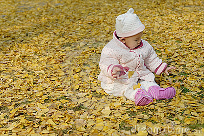 A chinese baby with autumn leaf