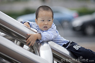 Chinese baby boy climb the ladder