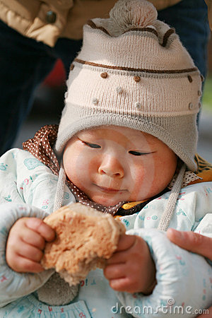 Chinese baby eating bread
